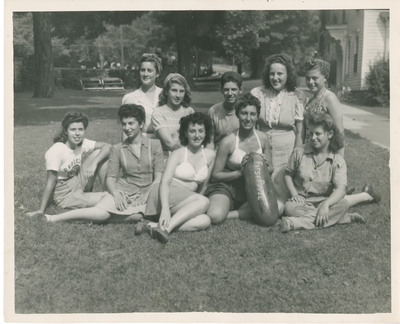 Group of Students Sitting on a Lawn