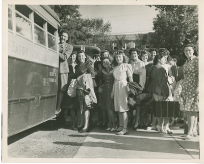 Female Students Getting on a Bus