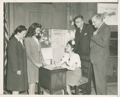 Two Female Students Signing Up For Farm Work