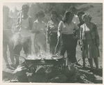 Students Cooking on an Outdoor Fire