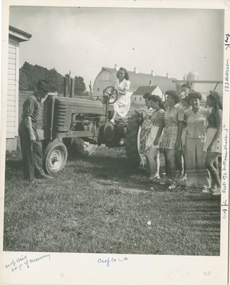 Female Students Learning About Tractors