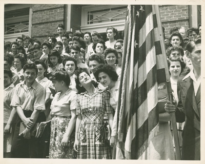 Students Posing with American Flag