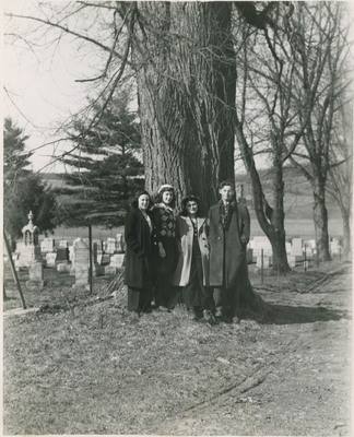 Students Standing in Front of Cemetery