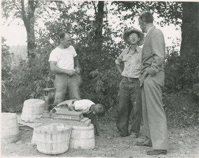 Workers on Farm with Harry D. Gideonse