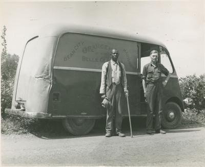 Men Standing in Front of Truck