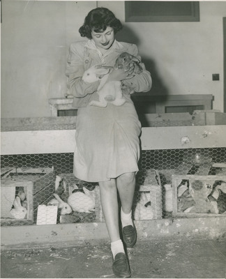 Student Holding Bunnies