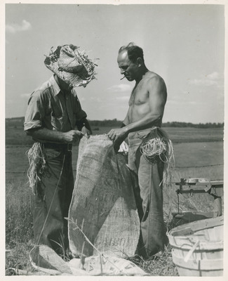 Workers Sewing a Burlap Bag