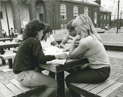 Students at Plaza Tables