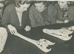 Geology Students Examining Paleontological Specimens
