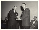 Kenneth Schweiger Congratulates at a Student at a New York Trade School Commencement Ceremony